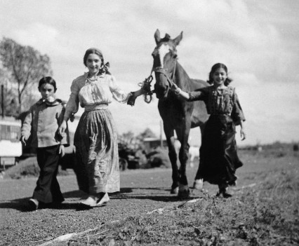 """Gypsy boy, Rosa and Simza walking a horse"""