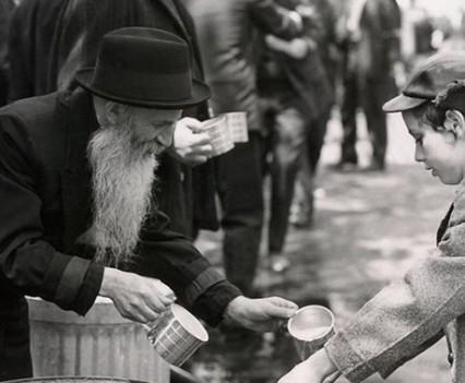 "Untitled, "" Rabbi Elye Chaim Roiblatt washing children's hands during Lag B'omer parade, Eastern Parkway, Brooklyn, 1963"""
